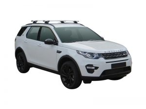 white discovery sport with whispbar through bar roof racks