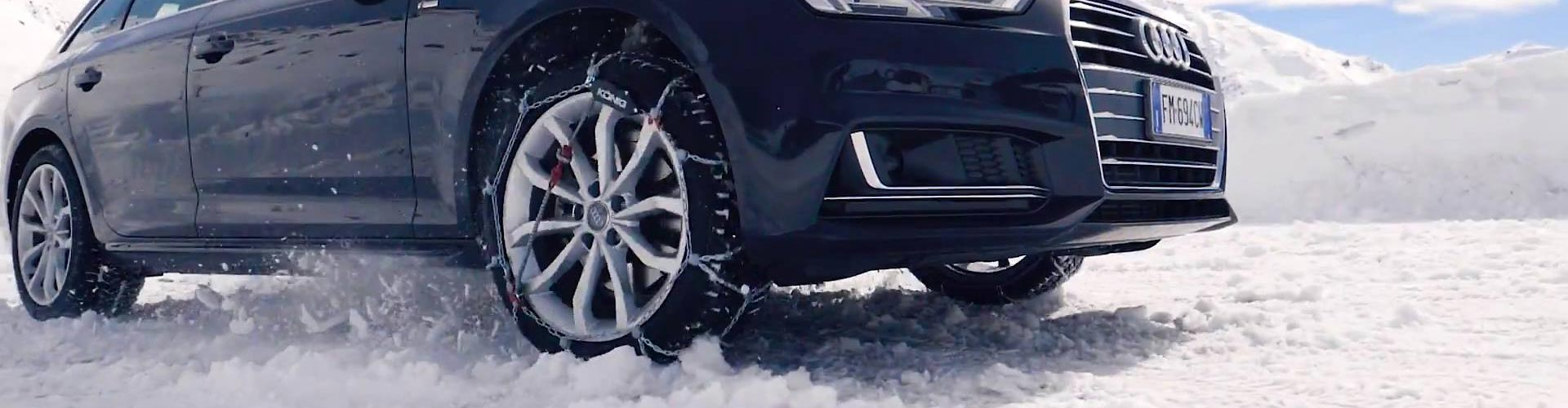 konig snow chain fitted to Audi front wheel in snow