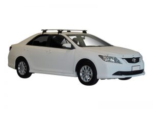 white toyota aurion with whispbar through bar roof racks
